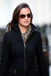 Pippa Middleton looked effortlessly cool in a pair of class aviators with gold frames.