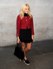 Pixie Lott visited BBC Radio 1 wearing a grid-patterned tweed jacket over a fur-trimmed LBD.