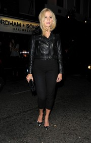 Pixie Lott arrived for a GQ party looking rocker-chic in a black leather jacket by Hide.