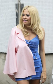 Pixie Lott stepped out of the ITV Studios wearing a pink blazer over a denim mini dress, both by Moschino.