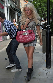 Pixie Lott was spotted at Circus carrying a cool patent leather shoulder bag.