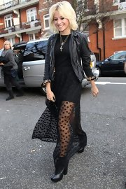 Pixie Lott enhanced her sexy Madonna vibe with layered cross necklaces and a leather jacket with cuffed leopard print sleeves.
