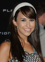 This textured white headband brought a preppy vibe to Lacey Chabert's outfit.