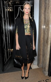 Poppy Delevingne arrived for Claridge's Christmas tree lighting ceremony carrying a sophisticated black exotic-skin tote.