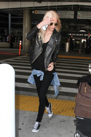 Poppy Delevingne looked casual-chic in a leather jacket while making her way through LAX.