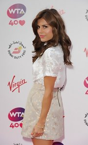 Zoe Hardman paired a gold brocade mini skirt with a white silk blouse for her youthful pre-Wimbledon party look.