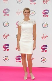 Andrea Hlavackova opted for a classic look with this lace-panel white cocktail dress when she attended the pre-Wimbledon party.