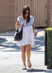Rachel Bilson was spotted out wearing a white maternity mini with a printed yoke.