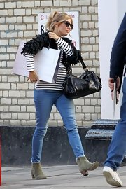 Sienna Miller filmed an advertisement in London wearing a pair of sage green suede ankle boots.