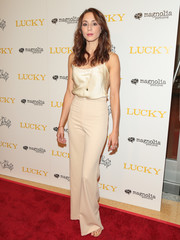 Troian Bellisario opted for a simple yet chic champagne silk cami when she attended the premiere of 'Lucky.'