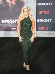 Bebe Rexha matched her dress with a pair of emerald velvet pumps.