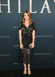 Jennifer Jason Leigh pulled her look together with a sequined clutch.