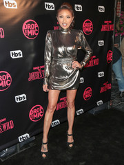 Jeannie Mai paired her dress with black ankle-strap peep-toes.