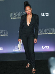 Regina King styled her jumpsuit with a pair of strappy black and gold heels.