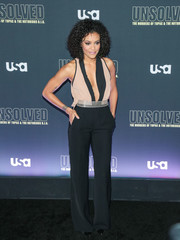 Annie Ilonzeh rocked a plunging two-tone jumpsuit at the premiere of 'Unsolved: The Murders of Tupac and the Notorious B.I.G.'