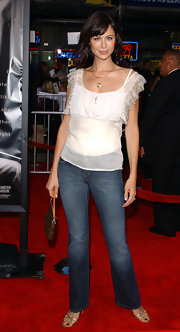 Catherine Bell paired a white ruffle blouse with blue jeans for a casual girly look.