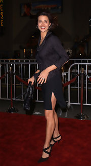 That slit on Catherine Bell's black mini skirt gave her subdued outfit a dose of sexiness.
