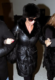 Katie wore a leather coat with a fur trim and matching fur hat to LAX.