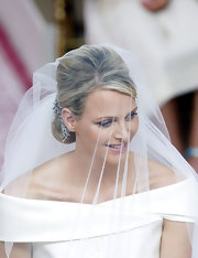 Charlene Wittstock, the latest royal bride, looked beautiful and elegant at her wedding ceremony. She opted for a classic updo pinned with jewels to match her Giorgio Armani wedding gown.