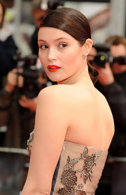 Gemma Artenson showed off her stunning classic bun while walking the carpet in her pre-fall Valentino dress.