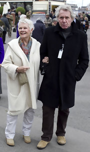 Judi Dench attended the Hennessy God Cup in a cozy looking knee length trench coat.