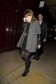 Princess Eugenie chose a more subtle evening look with this gray wool coat with leather sleeves.