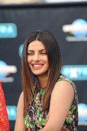 Priyanka Chopra showed off a perfect layered cut during her appearance on 'Extra.'