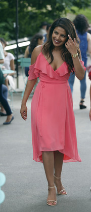 Priyanka Chopra was spotted on the set of 'Isn't It Romantic' wearing a sweet pink wrap dress.