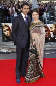 Abhishek Bachchan matched his wife's elegance with a three-piece charcoal suit at the 'Raavan' premiere.