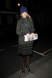 Rachel McAdams kept warm by layering an charcoal wool coat over her striped dress.