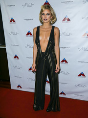 AnnaLynne McCord stole the spotlight in a black and gold striped jumpsuit with a barely-there bodice during her sister Rachel's birthday party.