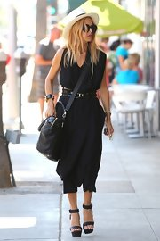 Rachel got funky with layers wearing this draped black number out in Beverly Hills.