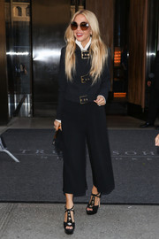 Embellished black platform sandals completed Rachel Zoe's chic attire.