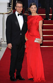 Crown Princess Victoria looked absolutely enchanting in her silky red ruffle-accented evening dress.