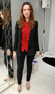 Rebecca Hall added pop to her no-nonsense blazer with a red button-down blouse.