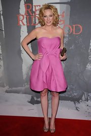 Virginia dons a youthful bubble gum pink strapless dress to the 'Red Riding Hood' premiere.