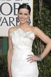 Kate's earrings become the focal point of this whole look with its amazing color and grand size.