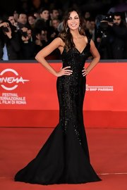 Madalina Ghenea was the embodiment of elegance in a body-conscious sequined V-neck gown with a mesmerizing mermaid skirt.