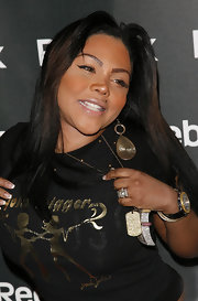 Lil Kim was seen at the Reebok launch all blinged out with gold jewelry including a pair of dangling earrings.