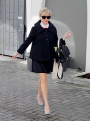 Reese Witherspoon stepped out in Beverly Hills looking darling in a black swing jacket teamed with a mini.
