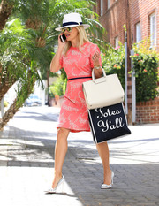 Reese Witherspoon looked flirty and feminine in a floral pink above-the-knee frock that featured a navy stripe around her waistline while out and about.