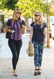 Reese Witherspoon took a stroll wearing the Love Field Knoxville print pants from her Draper James line.