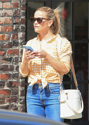 Reese Witherspoon shielded her eyes with a pair of tortoiseshell wayfarers by Draper James.