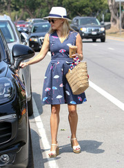 Reese Witherspoon amped up the summery feel with a straw tote by Kayu.