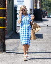 Reese Witherspoon looked perky in a gingham-print shirtdress by Draper James while running errands.