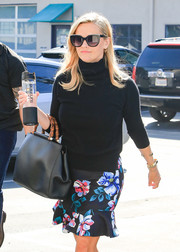 Reese Witherspoon stepped out on a sunny day in LA wearing a pair of oversized cateye shades.