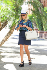 Reese Witherspoon looked ultra girly (as always) in a blue floral blouse by Draper James while out and about.