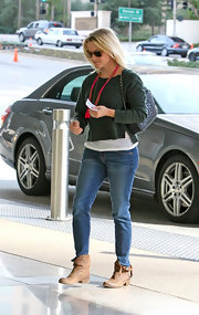 Reese Witherspoon kept her street style relaxed in a pair of slightly look medium wash jeans.