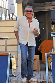 Roberto paired his classic jeans with a cream button down shirt.