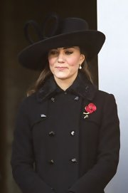 Kate Middleton looked prim and proper in a bow-bedecked wide-brimmed hat.